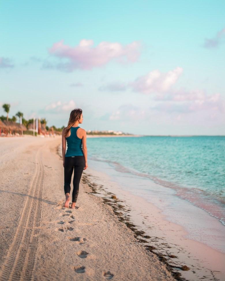 Jenny walking coast of Excellence Playa Mujeres