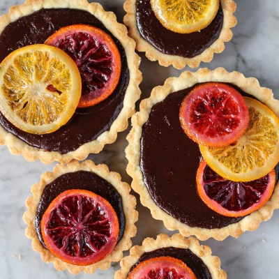 bittersweet chocolate truffle tart with candied oranges