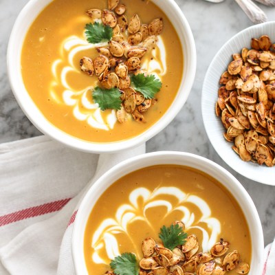 roasted pumpkin soup with spicy toasted pumpkin seeds and yogurt