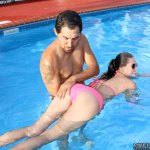 04-round-ass-teen-brunette-bikini-pool