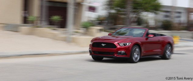 2015 Ford Mustang EcoBoost Convertible drving 1