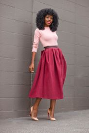knitted pink top, dark red skirt