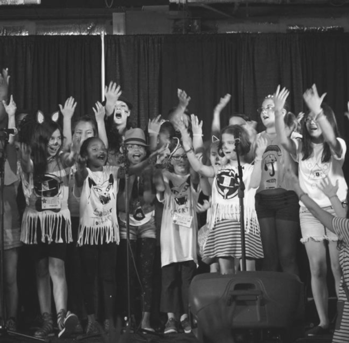 Campers singing on stage