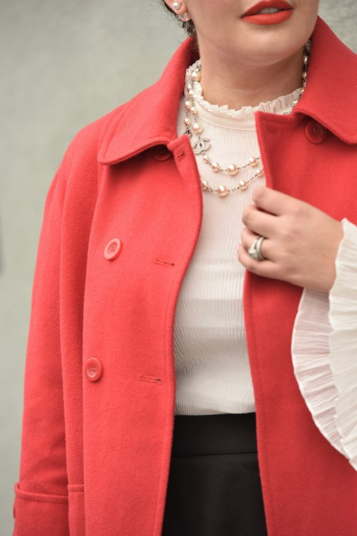 Girl With Curves blogger Tanesha Awasthi wears a bell sleeve blouse, red swing coat and Chanel necklace.