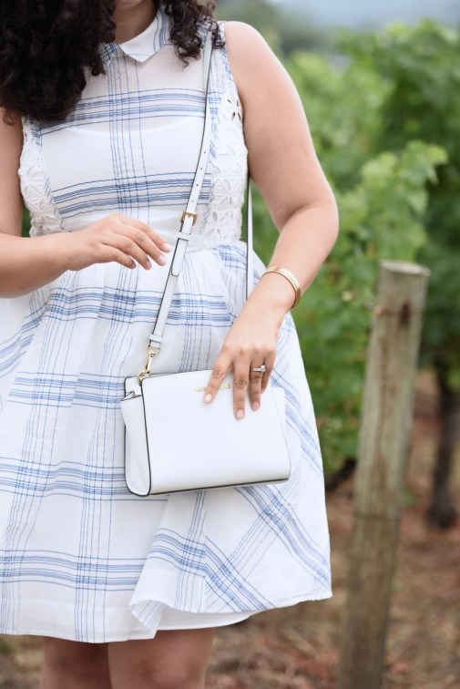 Girl with Curves featuring a Plaid dress, white Michael Kors bag, gold bangles