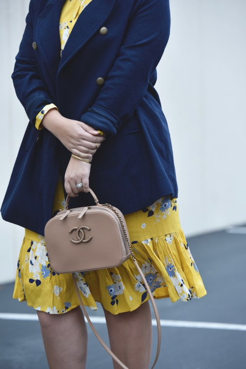 Girl With Curves blogger Tanesha Awasthi, in post Winter Brights, is wearing an Old Navy yellow floral Dress and navy peacoat.