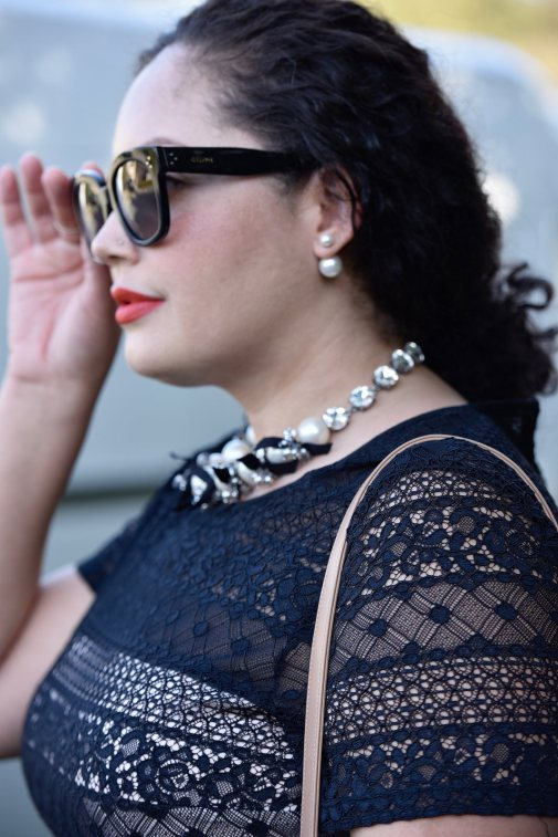 Girl With Curves wearing a pearl necklace from Ann Taylor, Audrey Sunglasses from Celine and Lace Dress from Maggy London at Nordstrom.