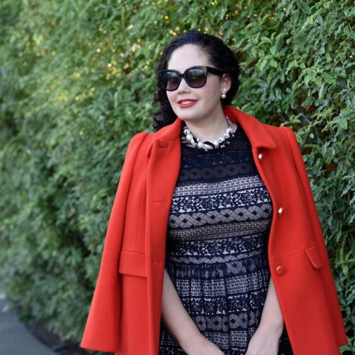 Girl With Curves wearing a pearl necklace from Ann Taylor, Audrey Sunglasses from Celine, Coat from Kate Spade, Lace Dress from Maggy London at Nordstrom.