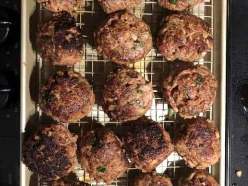pan seared meatballs draining on pan
