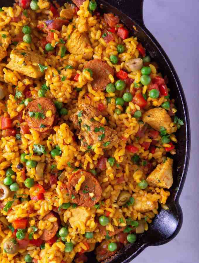 Chicken and chorizo Paella in cast iron skillet