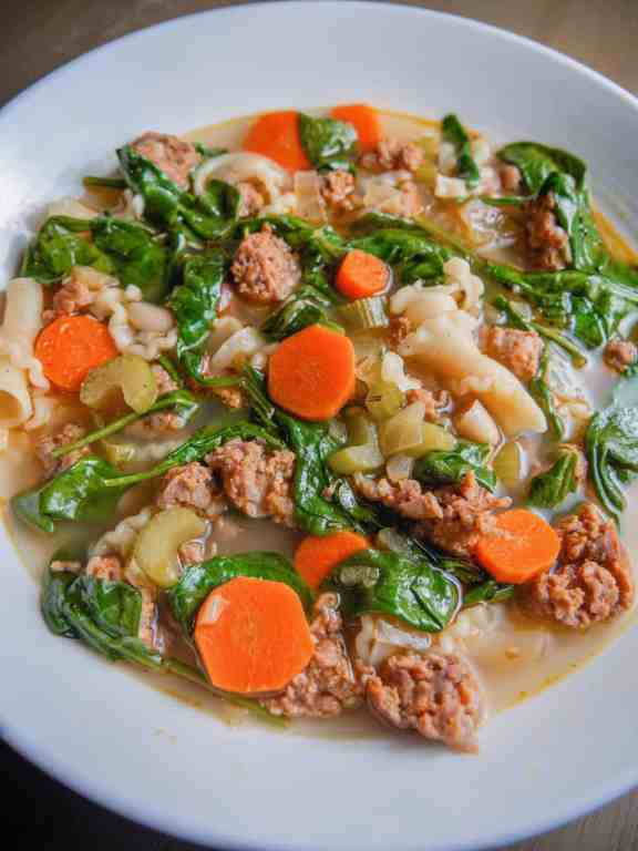 Close up of italian sausage white bean soup