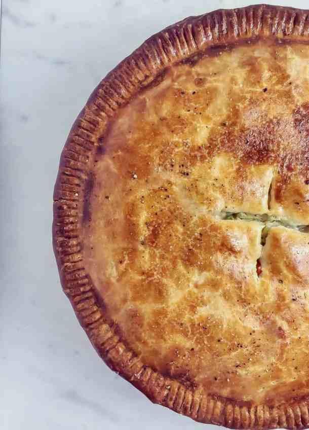overhead shot of golden brown chicken pot pie crust