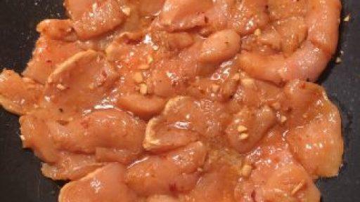 marinated chicken in wok
