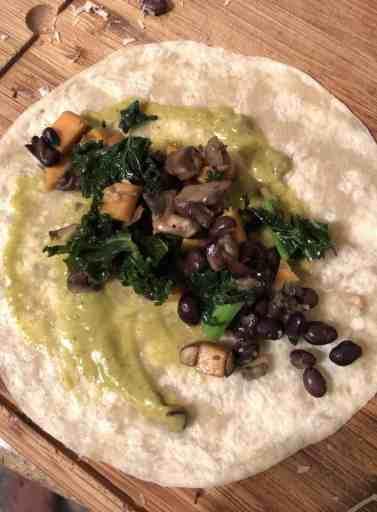 assembling enchilada with vegetables