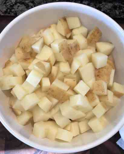 diced russet potatoes in a white bowl