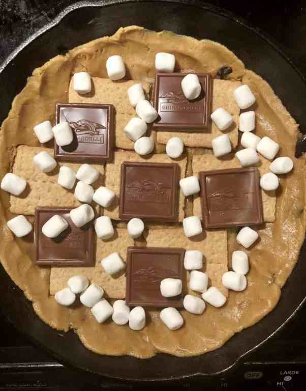 smores stuffing inside of a cast iron skillet