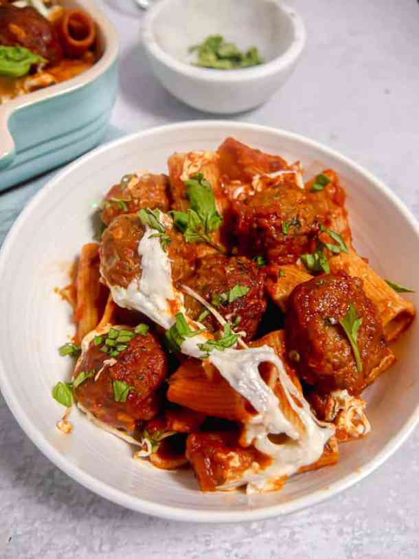 bowl of rigatoni, meatballs, and melty burrata cheese