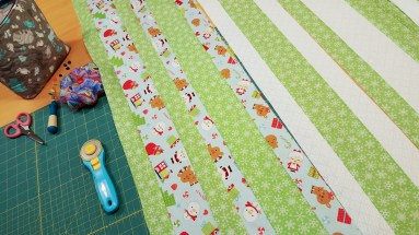 Strip sewing...isn't that Christmas print so cute?!