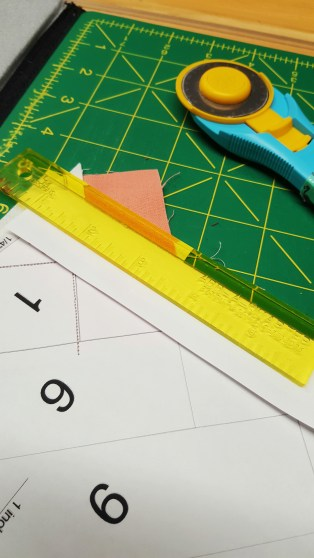 Add-A-Quarter ruler for trimming excess fabric from paper piecing.