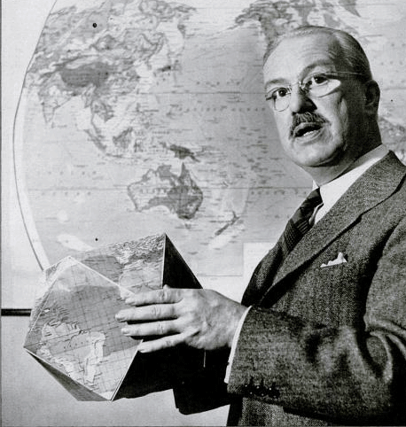 R. Buckminster Fuller holding a Dymaxion Map in Life Magazine, 1943.