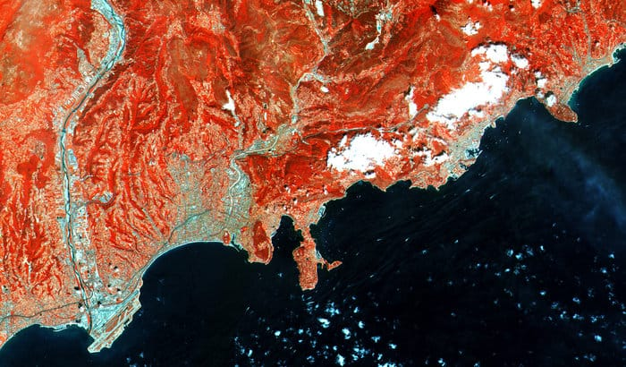 Acquired on 27 June 2015 at 10:25 UTC (12:25 CEST), just four days after launch, this close-up of France's southern coast from Nice airport (lower left) to Menton (upper right) is a subset from the first image from the Sentinel-2A satellite. This false colour image was processed including the instrument's high-resolution infrared spectral channel.