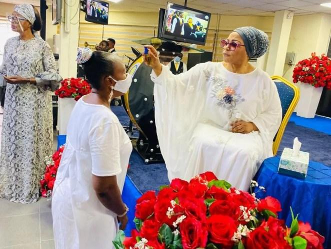 Billionaire businesswoman Folorunso Alakija spotted anointing her church members