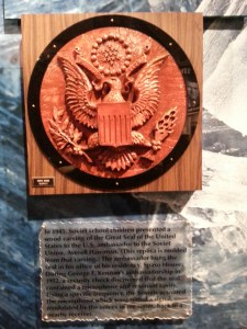 """Pictured: A mold of a """"gift"""" crafted by Soviet children during the Cold War. The plaque reads, """"In 1945, Soviet school children presented a wood carving of the Great Seal of the United States to the U.S. ambassador to the Soviet Union, Averell Harriman. (This replica is molded from that carving.) The ambassador hung the seal in his office of his residency, Spaso House. During George F. Kennan's ambassadorship in 1952, a security check discovered that the seal contained a microphone and resonant cavity. Using a specific frequency. the Soviets activated the microphone which transmitted a signal, modulated by the voices in the room, back to a nearby receiver."""""""