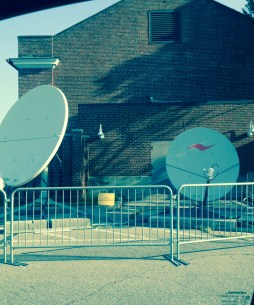 Satellite dishes behind theatre to receive video feed from Guantanimo Bay