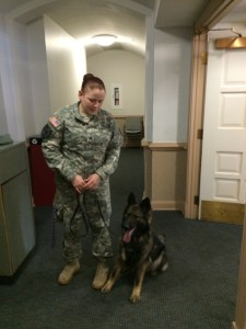 Drug sniffing dog Axa and her handler