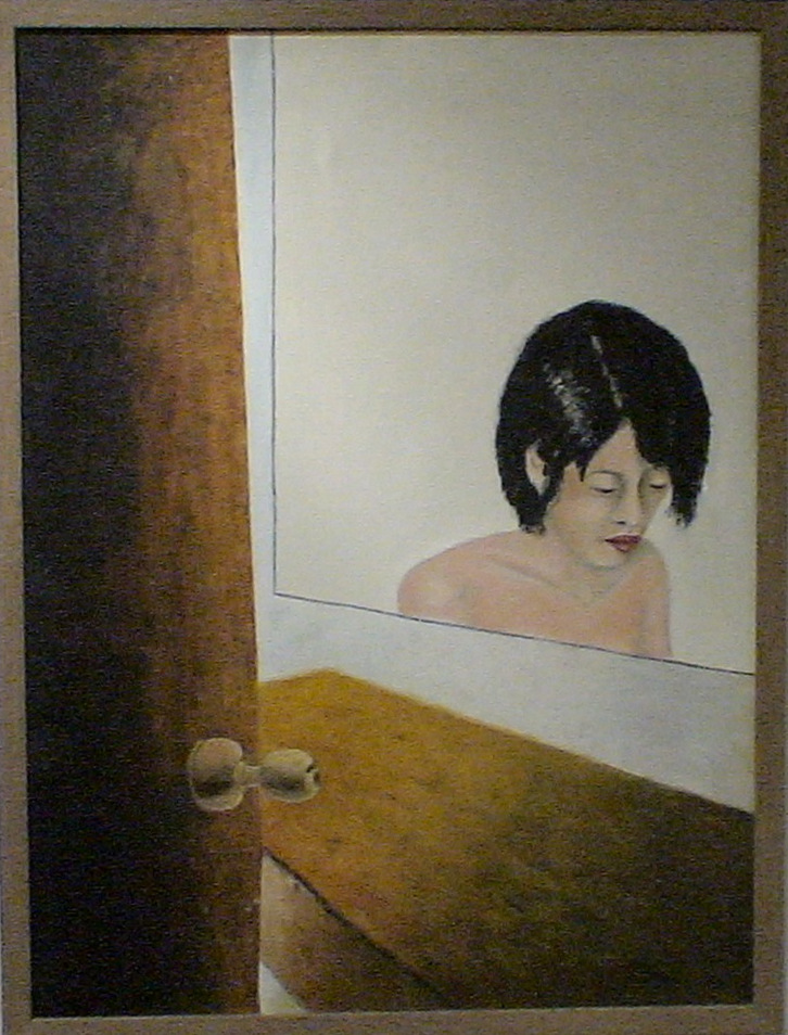 A seated bare shouldered woman seen in a mirror through a partially open door.