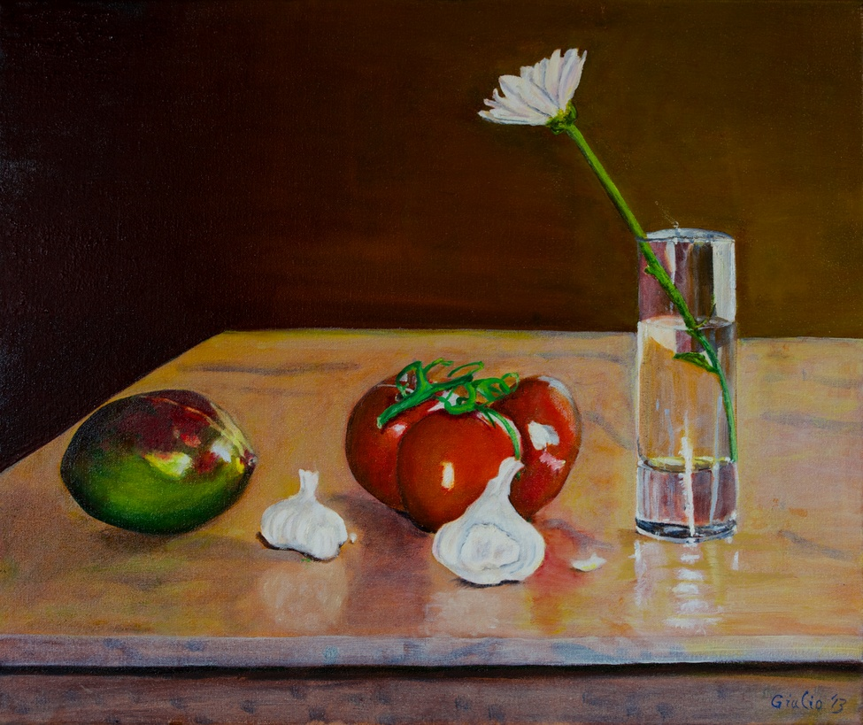 still life of mango, tomatoes and garlic with flower in glass of water