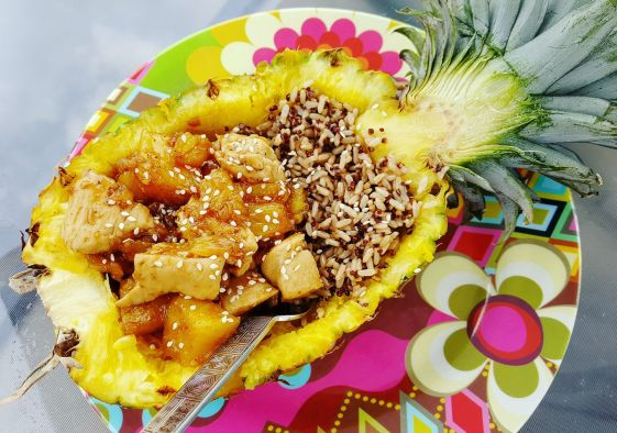 Teriyaki chicken served in a pineapple with wild rice - Give It A Whirl Girl