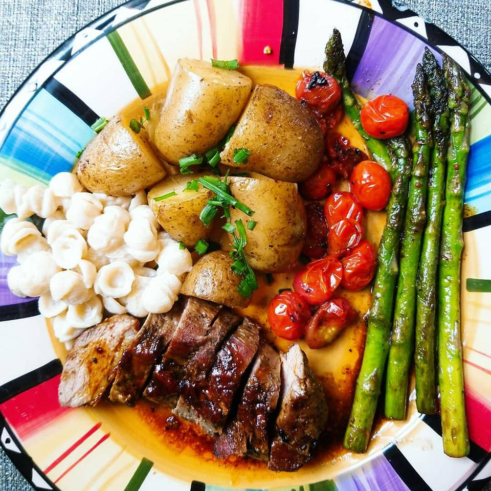 Pan Seared Duck Breasts With Duck Fried Potatoes, Asparagus, and Grape Tomatoes