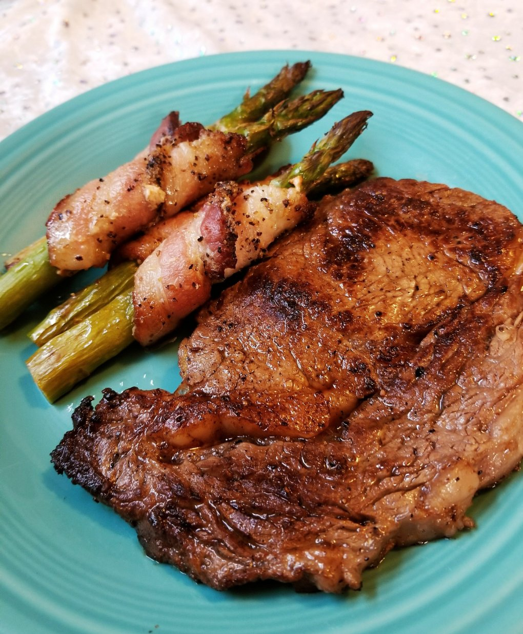 Primal Kitchen Sesame Ginger Ribeye Steak and Bacon-Wrapped Asparagus