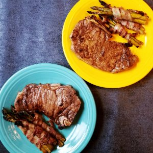 Primal Kitchen Bone-In Balsamic Strip Steaks served with Applegate Bacon-Wrapped Asparagus