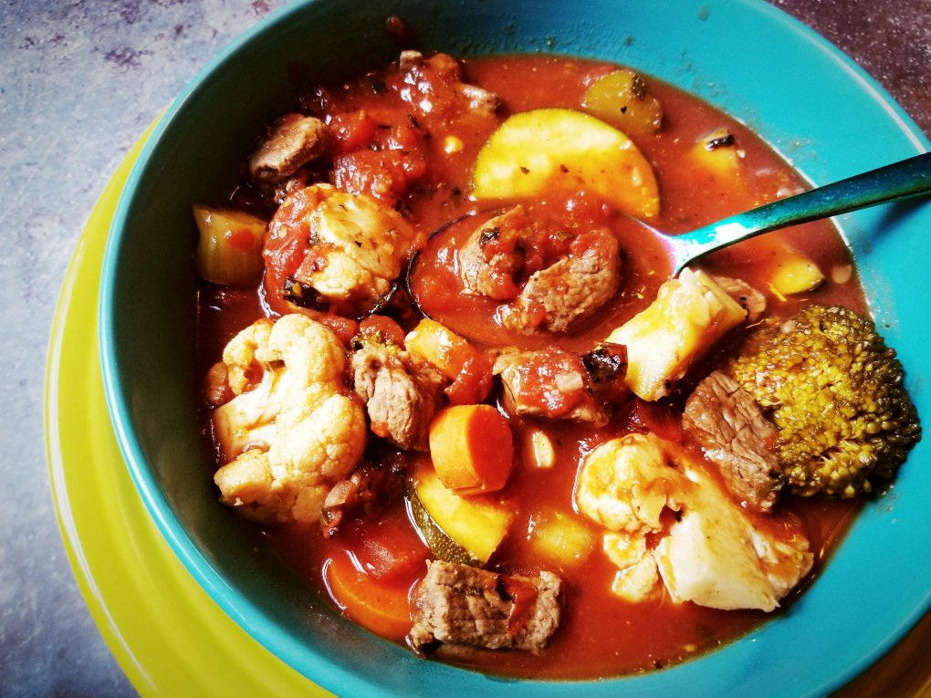 Paleo Vegetable Beef Soup and a big hunk of meat on the spoon!