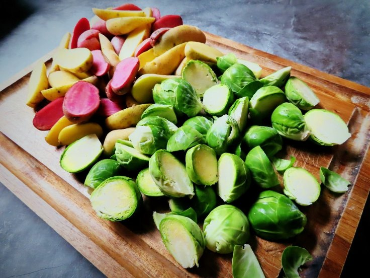 Fingerling potatoes and brussels sprouts on the cutting board