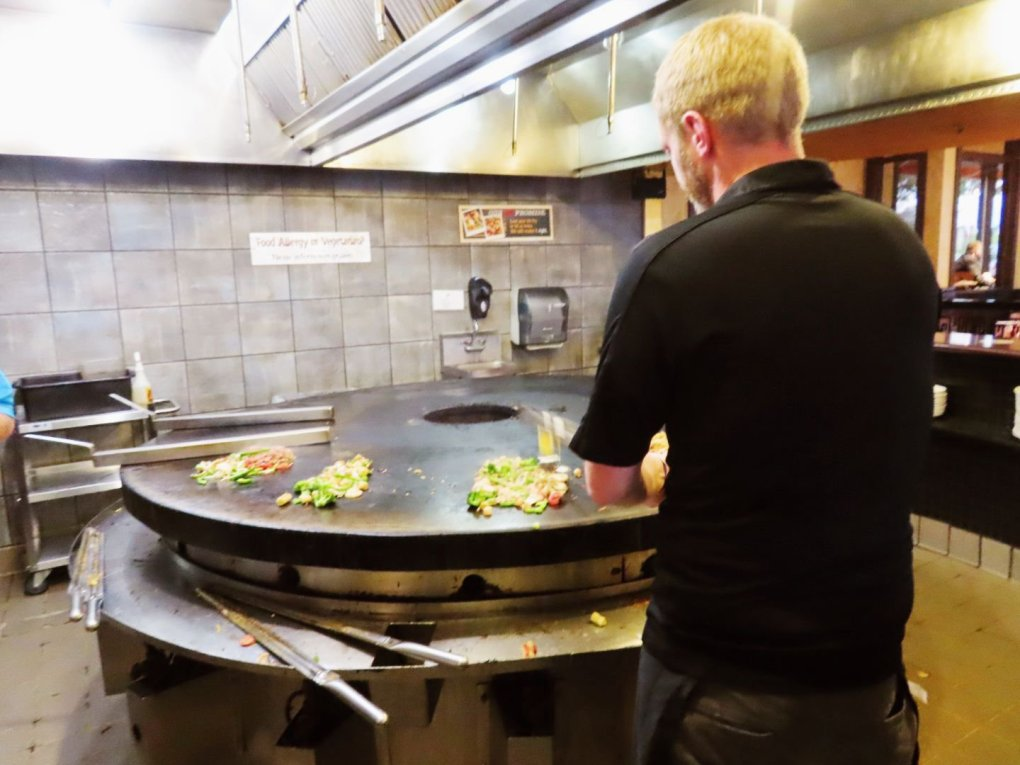 Getting my food grilled at BD's Mongolian Grill