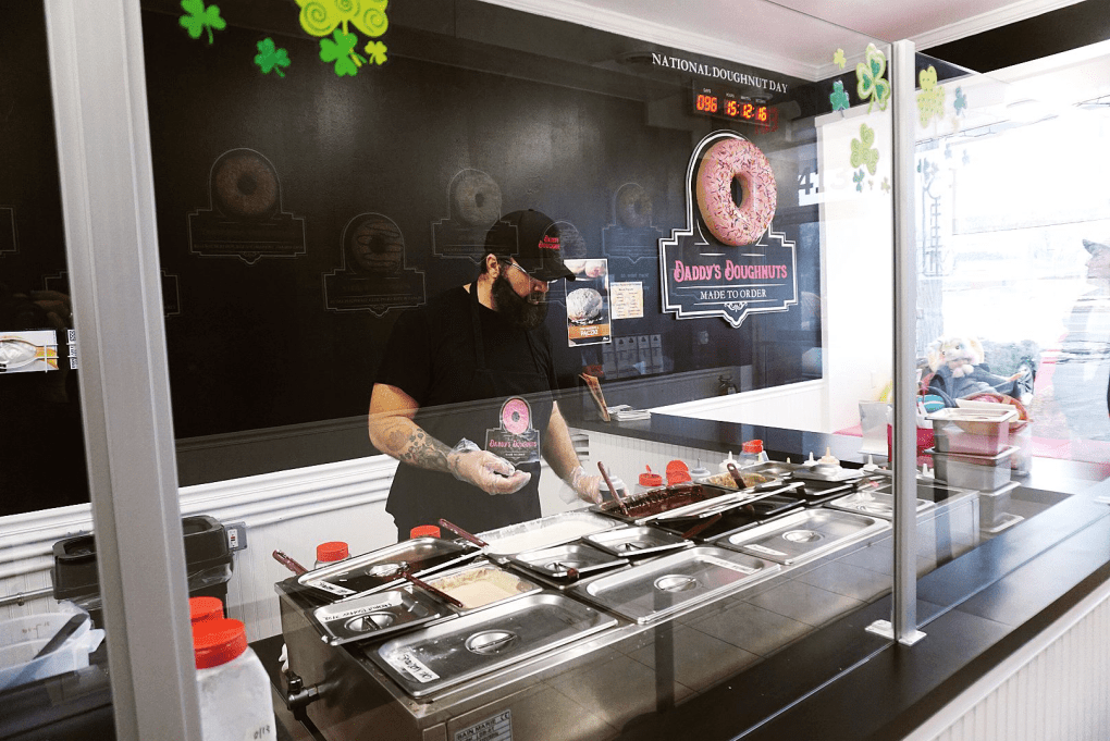 One of the employees creating out made-to-order custom Daddy's Doughnuts