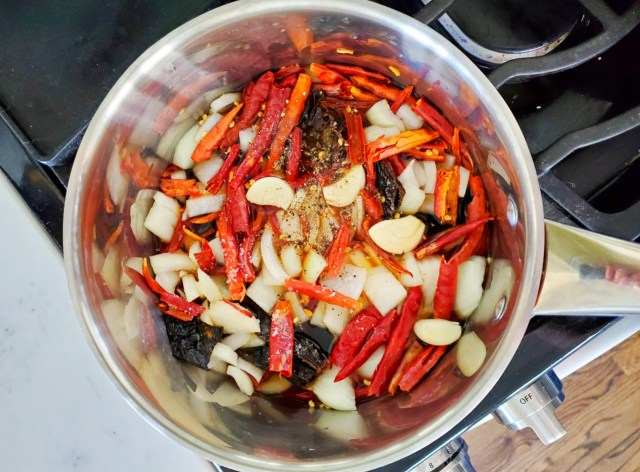 Dried Chilis in saucepan of water cooking