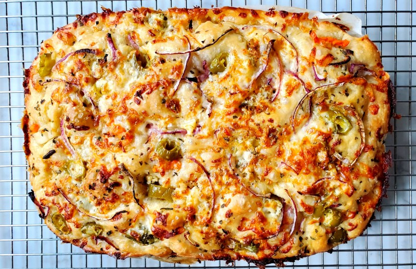 Focaccia Bread with Mozzarella, Hot Peppers and Red Onions On Cooling Rack