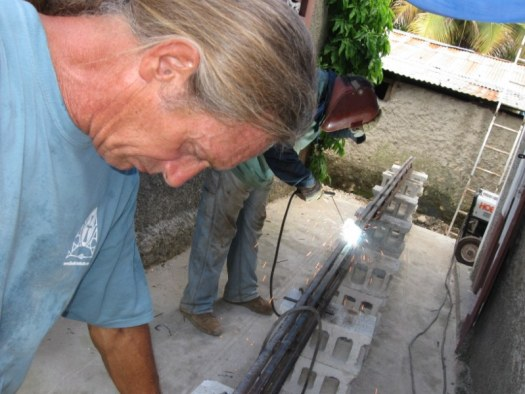 Kenny assisting the welder dude