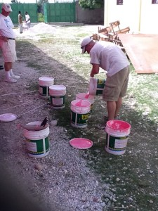 Daniel boxing up the pepto paint for the final coat.