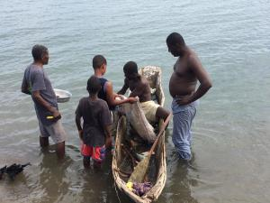 Pastor Harry negotiating fresh fish and crabs.