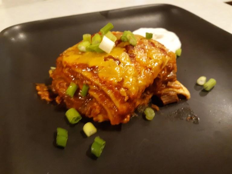 Amazing Enchilada Lasagna - layers of cheesy, spicy goodness!