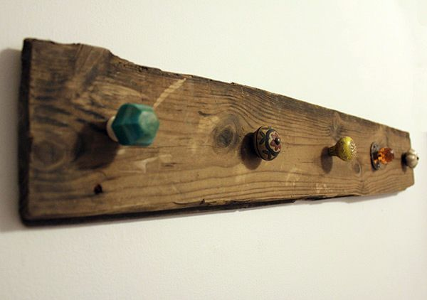 Screw cheap furniture knobs into wood for a necklace holder