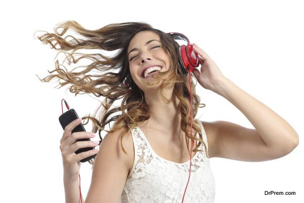 Happy girl dancing and listening to the music