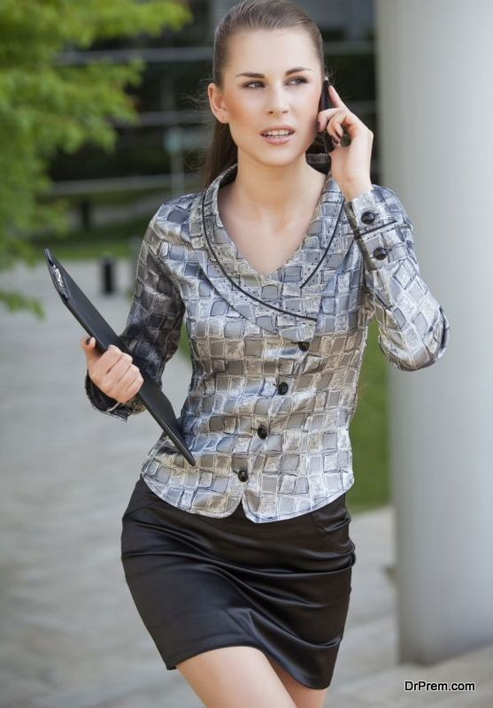 businesswoman walking and talking on cell phone