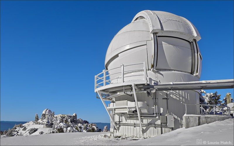 The Automated Planet Finder Telescope dome gleams in the sun after a winter snowfall.