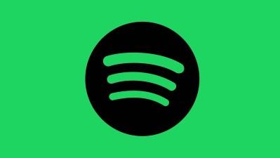 Logo do Spotify -- um círculo preto com ondas representando o som -- sobre fundo verde.